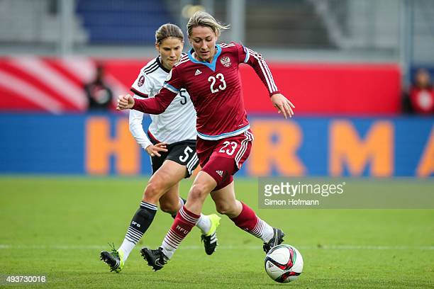 Elena Danilova of Russia is challenged by Annike Krahn of Germany during the UEFA Women's Euro 2017 Qualifier match between Germany and Russia at...