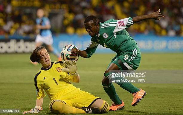 Elena De Toro of Spain saves at the feet of Aminat Yakubu of Nigeria during the FIFA U17 Women's World Cup Quarter Final match between Nigeria and...