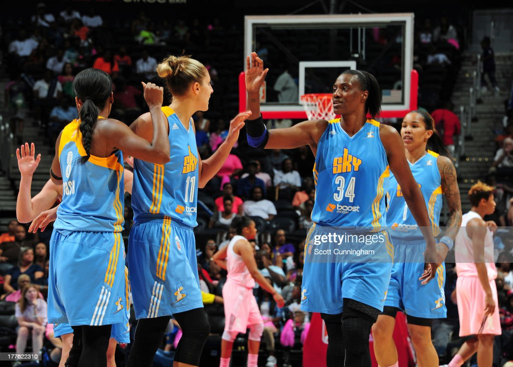 Elena Delle Donne #11 and Sylvia Fowles #34 of the Chicago Sky celebrate after a score against the Atlanta Dream at Philips Arena on August 24 2013 in Atlanta, Georgia.