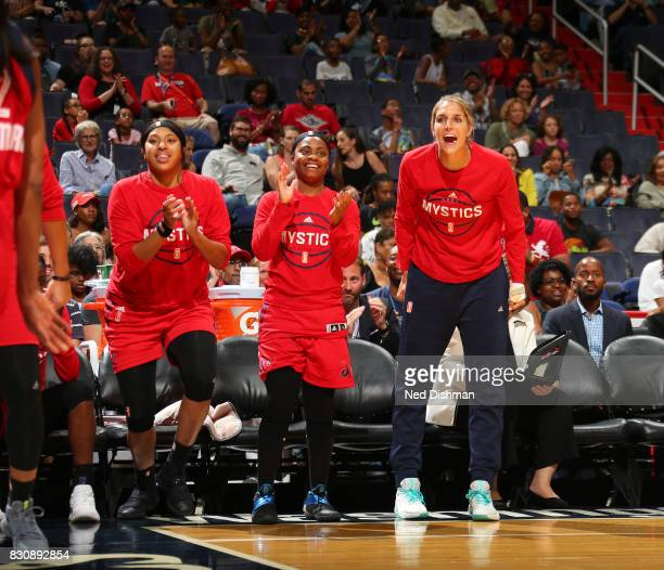 Elena Delle Donne Ivory Latta and Tianna Hawkins of the Washington Mystics react to a play from courtside against the Indiana Fever on August 12 2017...
