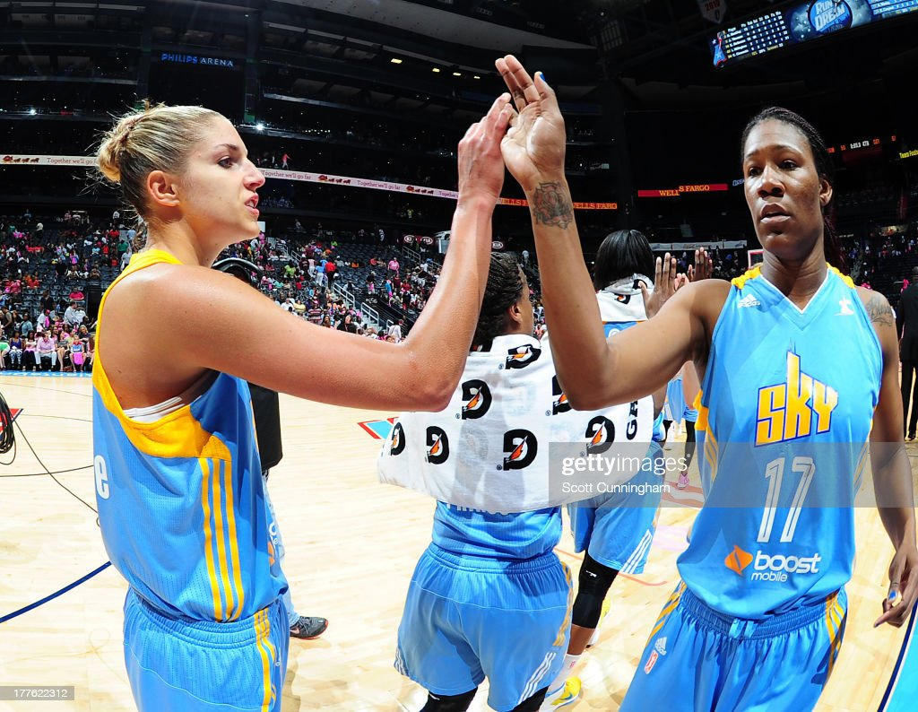 Elena Delle Donne #11 of the Chicago Sky celebrates with Avery Warley #17 after the game against the Atlanta Dream at Philips Arena on August 24 2013 in Atlanta, Georgia.
