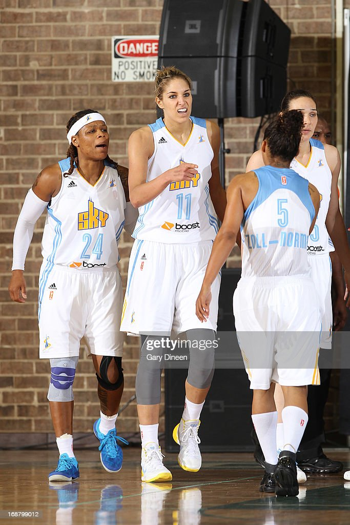 Elena Delle Donne #11 of the Chicago Sky celebrates with teammates D'Andra Moss #24 and Shamee Zoll-Norman #5 during a timeout in the pre-season game against the New York Liberty on May 15, 2013 at the Jacoby D. Dickens Physical Education and Athletic Center on the campus of Chicago State University in Chicago, Illinois.