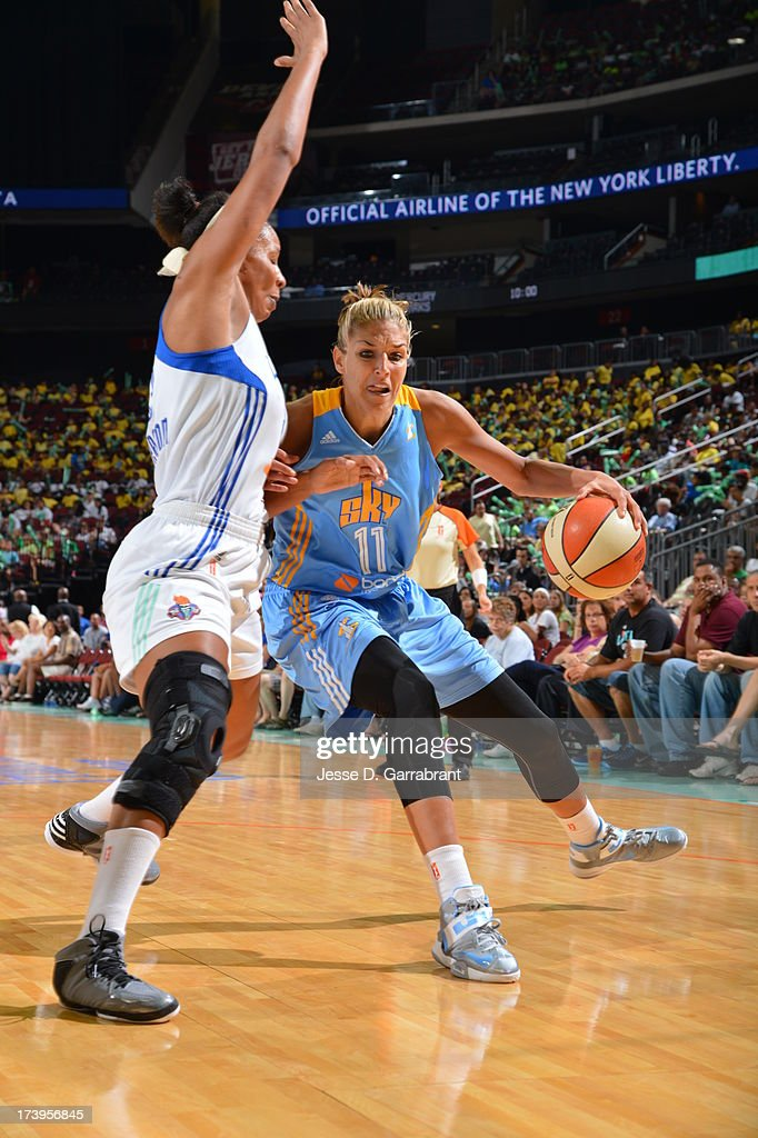 <a gi-track='captionPersonalityLinkClicked' href=/galleries/search?phrase=Elena+Delle+Donne&family=editorial&specificpeople=5042380 ng-click='$event.stopPropagation()'>Elena Delle Donne</a> #11 of the Chicago Sky drives against Plennette Pierson #33 of the New York Liberty during the game on July 18, 2013 at Prudential Center in Newark, New Jersey.