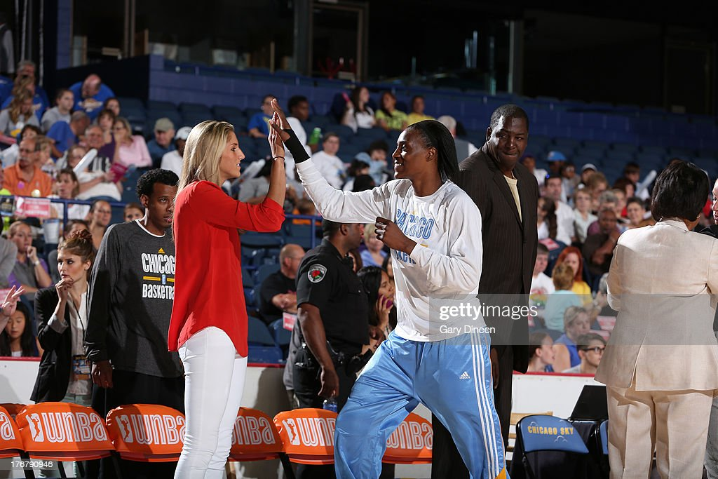 Elena Delle Donne #11 of the Chicago Sky high fives teammate Sylvia Fowles #34 during introductions prior to the start of the game against the Connecticut Sun on August 18, 2013 at the Allstate Arena in Rosemont, Illinois. Delle Donne was sidelined with an ankle injury she sustained on August 13th.