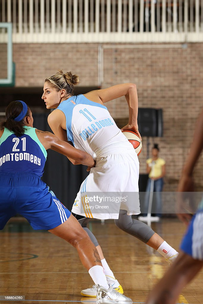 Elena Delle Donne #11 of the Chicago Sky looks to pass while defended by Alex Montgomery #21 of the New York Liberty during the pre-season game on May 15, 2013 at the Jacoby D. Dickens Physical Education and Athletic Center on the campus of Chicago State University in Chicago, Illinois.