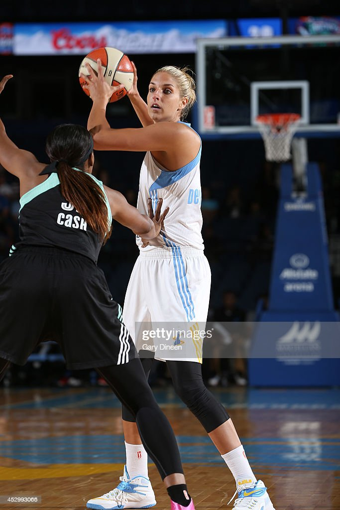 <a gi-track='captionPersonalityLinkClicked' href=/galleries/search?phrase=Elena+Delle+Donne&family=editorial&specificpeople=5042380 ng-click='$event.stopPropagation()'>Elena Delle Donne</a> #11 of the Chicago Sky looks to pass while guarded by Swin Cash #32 of the New York Liberty during the game on July 31, 2014 at Allstate Arena in Rosemont, Illinois.