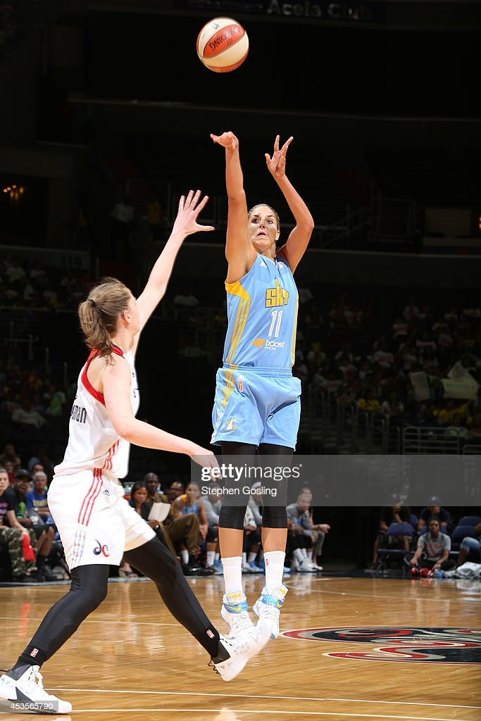 Elena Delle Donne #11 of the Chicago Sky shoots against Emma Meesseman #33 of the Washington Mystics at the Verizon Center on August 13, 2014 in Washington, DC.