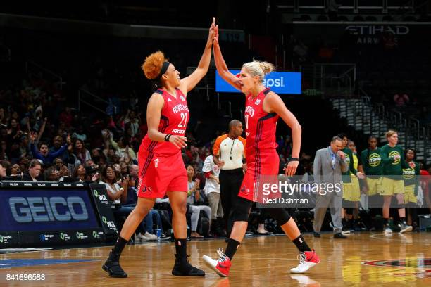 Elena Delle Donne of the Washington Mystics and Tianna Hawkins of the Washington Mystics high five each other during the game against the Seattle...