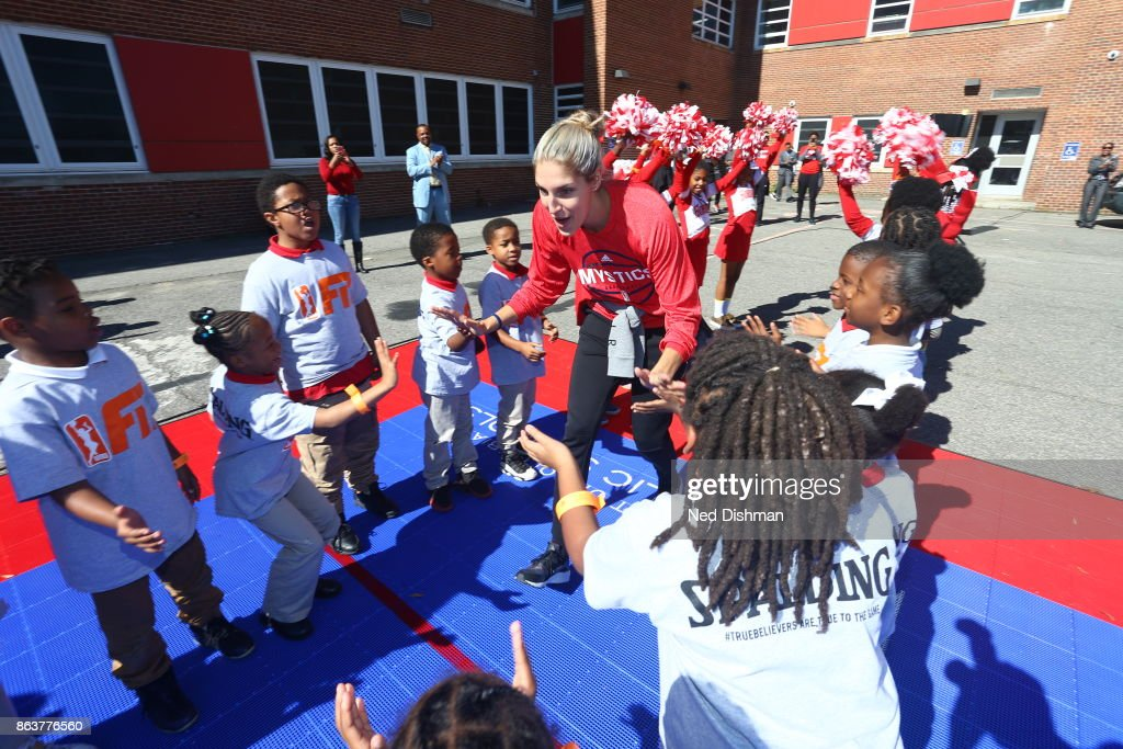 Elena Delle Donne of the Washington Mystics high fives kids of Hendley Elementary school during a court dedication on October 17, 2017 at Hendley Elementary school in Washington, DC.