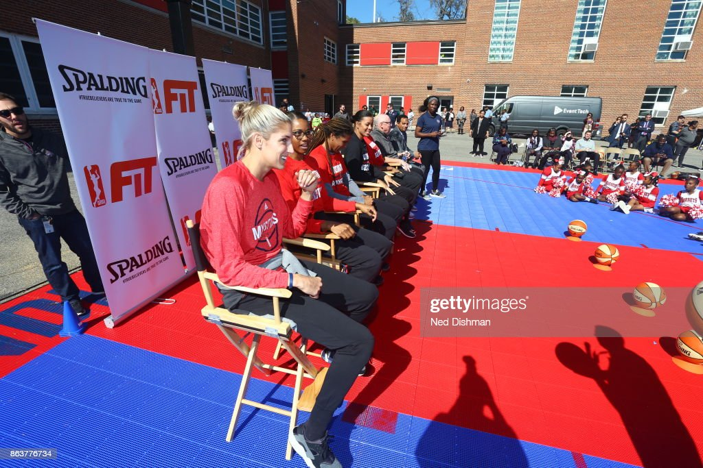 Elena Delle Donne of the Washington Mystics speaks with kids from Hendley Elementary school during a court dedication and Fit Clinic on October 17, 2017 at Hendley Elementary school in Washington, DC.