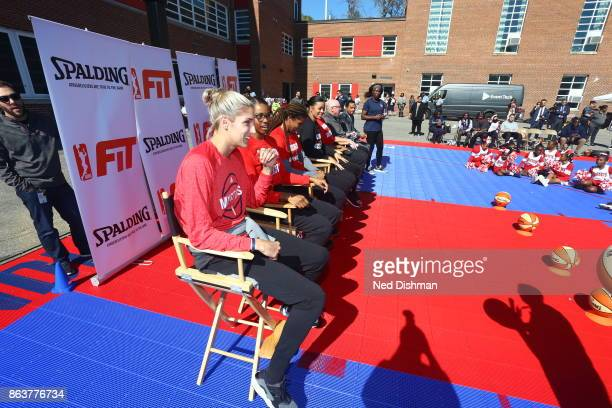 Elena Delle Donne of the Washington Mystics speaks with kids from Hendley Elementary school during a court dedication and Fit Clinic on October 17...