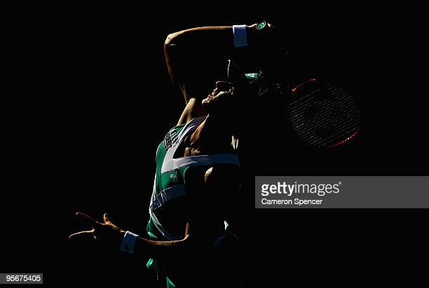 Elena Dementieva of Russia serves in her first round match against Francesca Schiavone of Italy during day one of the 2010 Medibank International at...