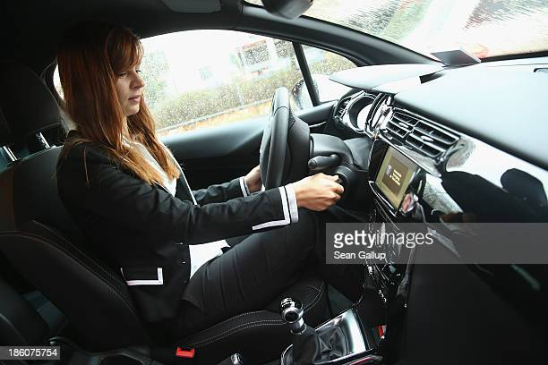 Elena Eybe starts a Flinkster carsharing car after she was recognized as the company 250000th customer on October 28 2013 in Berlin Germany Flinkster...