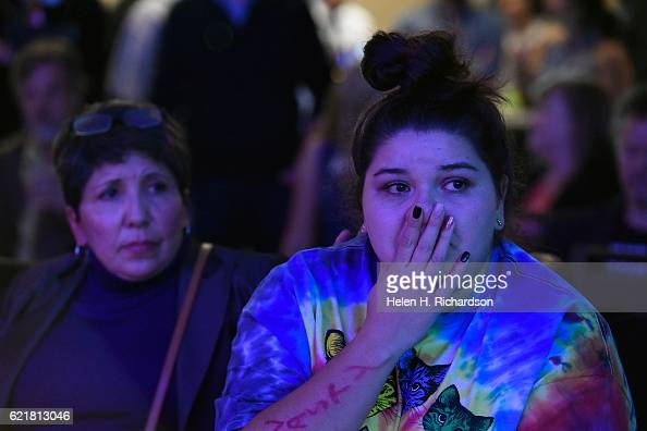 Elena Horsky right holds back tears as she and her mother Angeles Ortega left as they watch numbers continue to turn in favor of Republican candidate...