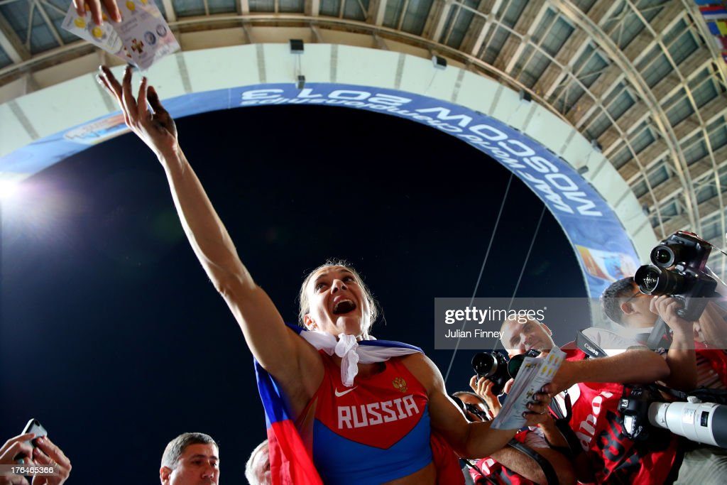 <a gi-track='captionPersonalityLinkClicked' href=/galleries/search?phrase=Elena+Isinbaeva&family=editorial&specificpeople=3230101 ng-click='$event.stopPropagation()'>Elena Isinbaeva</a> of Russia celebrates winning gold in the Women's pole vault final during Day Four of the 14th IAAF World Athletics Championships Moscow 2013 at Luzhniki Stadium on August 13, 2013 in Moscow, Russia.