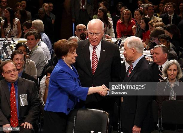 Elena Kagan nominee for the US Supreme Court left shakes hands with Senator Jeff Sessions a Republican from Alabama right as Senator Patrick Leahy a...