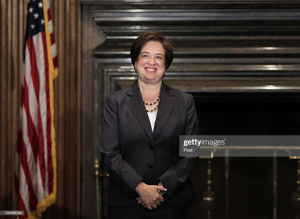 Elena Kagan smiles after being sworn in as the Supreme Court's newest member by Chief Justice John Roberts at the Supreme Court Building August 7, 2010 in Washington, DC. Kagan, 50, who replaces retired Justice John Paul Stevens, becomes the fourth woman to sit on the high court, and is the first Supreme Court justice in nearly four decades with no previous experience as a judge.