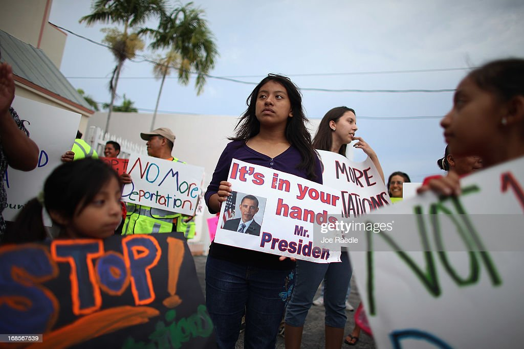 Elena Marquez (C) holds a sign reading 'it's in your hands Mr. President' as she and others participate in a rally calling on the President <a gi-track='captionPersonalityLinkClicked' href=/galleries/search?phrase=Barack+Obama&family=editorial&specificpeople=203260 ng-click='$event.stopPropagation()'>Barack Obama</a> to immediately suspend deportations and for Congress to pass an immigration reform that's inclusive of all 11 million undocumented people in the U.S. on May 11, 2013 in Homestead, Florida. The rally is part of what is being called a rolling fast in different places throughout the nation over the course of the next two months to bring what organizers say is a moral, prophetic voice to the immigration debate.