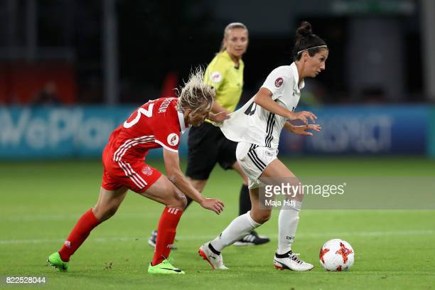 Elena Morozova of Russia and Sara DoorsounKhajeh of Germany battle for possession during the Group B match between Russia and Germany during the UEFA...