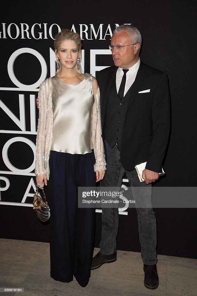 Elena Perminova and Alexander Lebedev attend the Giorgio Armani Prive show as part of Paris Fashion Week Haute Couture Spring/Summer 2014, at Palais de tokyo in Paris.
