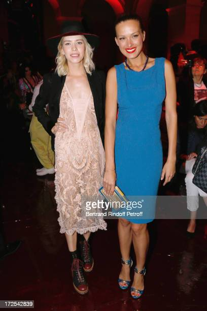 Elena Perminova and Petra Nemcova attend the Elie Saab show as part of Paris Fashion Week HauteCouture Fall/Winter 20132014 at Palais Brongniart on...