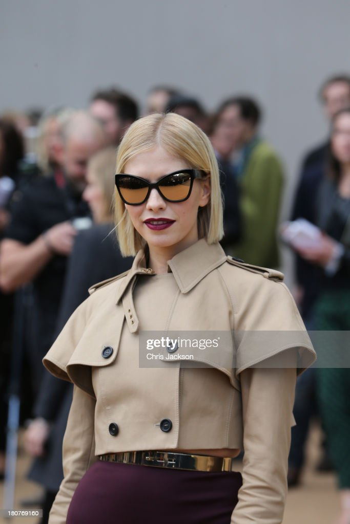 Elena Perminova attends the Burberry Prorsum show at London Fashion Week SS14 at Kensington Gardens on September 16, 2013 in London, England.