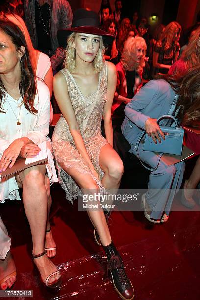 Elena Perminova attends the Elie Saab show as part of Paris Fashion Week HauteCouture Fall/Winter 20132014 at Palais Brongniart on July 3 2013 in...