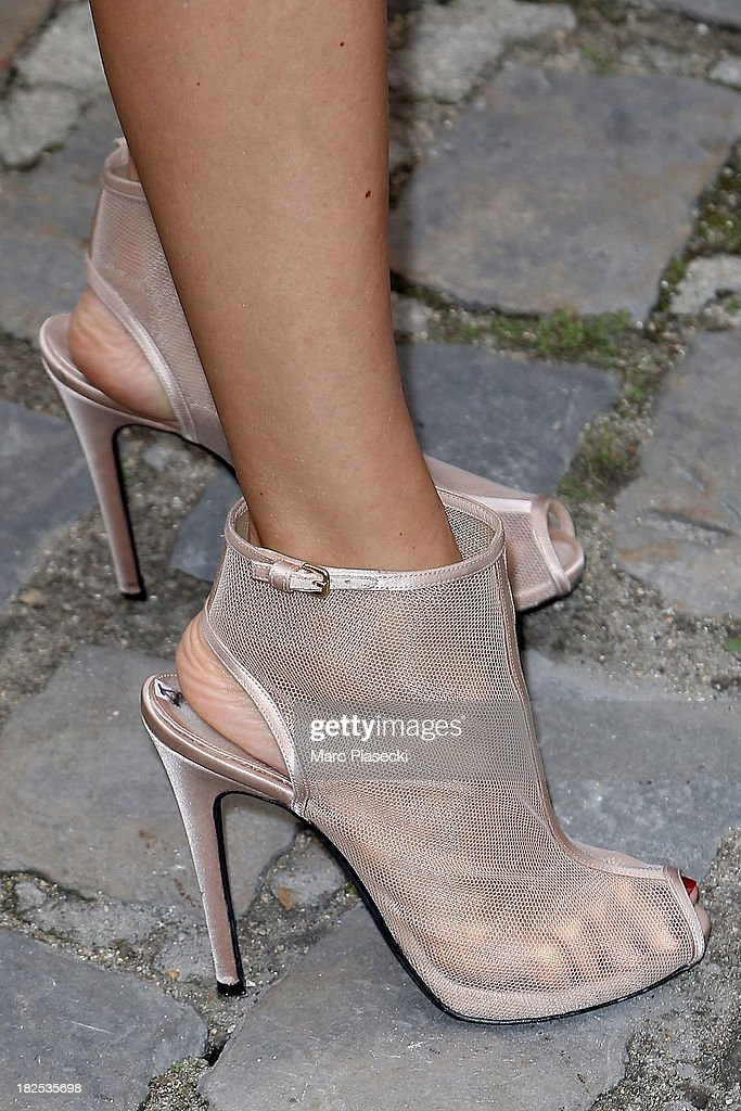 <a gi-track='captionPersonalityLinkClicked' href=/galleries/search?phrase=Elena+Perminova&family=editorial&specificpeople=6479553 ng-click='$event.stopPropagation()'>Elena Perminova</a> (shoe detail) attends the Giambattista Valli show as part of the Paris Fashion Week Womenswear Spring/Summer 2014 on September 30, 2013 in Paris, France.
