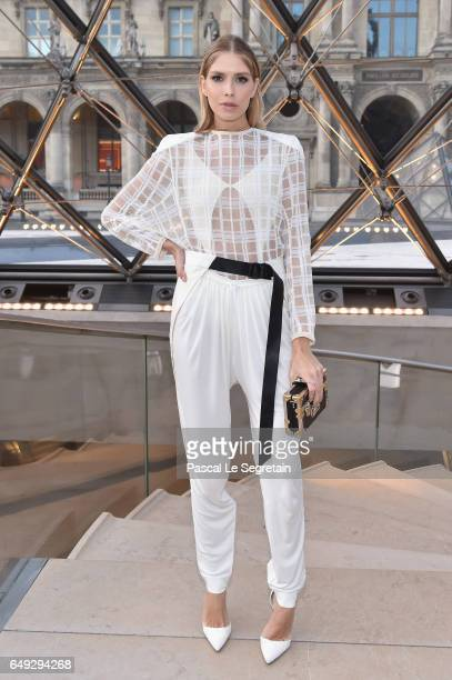 Elena Perminova attends the Louis Vuitton show as part of the Paris Fashion Week Womenswear Fall/Winter 2017/2018 on March 7 2017 in Paris France
