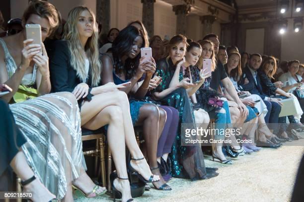 Elena Perminova Karidja Toure Deborah Francois Clotilde Courau Roxane Mesquida Olivia Palermo and Carine Roitfeld attend the Elie Saab Haute Couture...