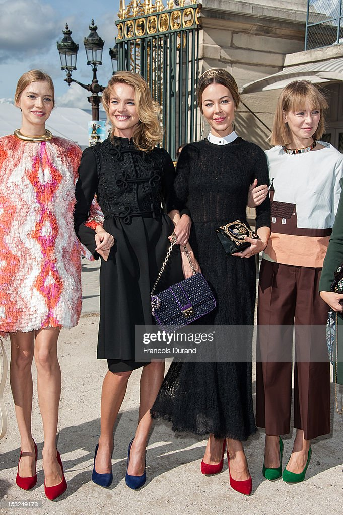 Elena Perminova, <a gi-track='captionPersonalityLinkClicked' href=/galleries/search?phrase=Natalia+Vodianova&family=editorial&specificpeople=203265 ng-click='$event.stopPropagation()'>Natalia Vodianova</a>, Ulyana Sergeenko and guest arrive at the Valentino Spring / Summer 2013 show as part of Paris Fashion Week at Espace Ephemere Tuileries on October 2, 2012 in Paris, France.