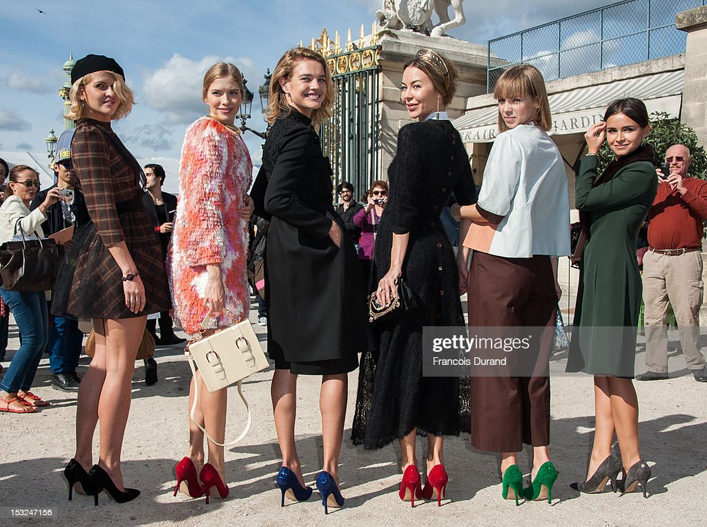 Elena Perminova, <a gi-track='captionPersonalityLinkClicked' href=/galleries/search?phrase=Natalia+Vodianova&family=editorial&specificpeople=203265 ng-click='$event.stopPropagation()'>Natalia Vodianova</a>, Ulyana Sergeenko and guests arrive at the Valentino Spring / Summer 2013 show as part of Paris Fashion Week at Espace Ephemere Tuileries on October 2, 2012 in Paris, France.