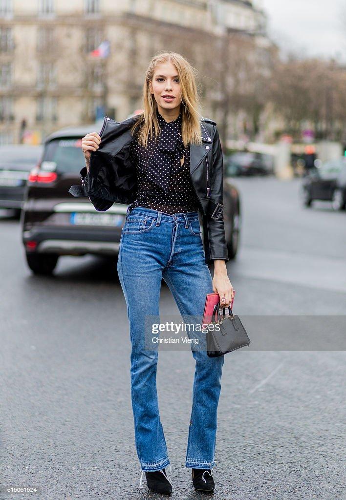 Elena Perminova wearing a black leather jacket and blue denim jeans outside Miu Miu during the Paris Fashion Week Womenswear Fall/Winter 2016/2017 on...