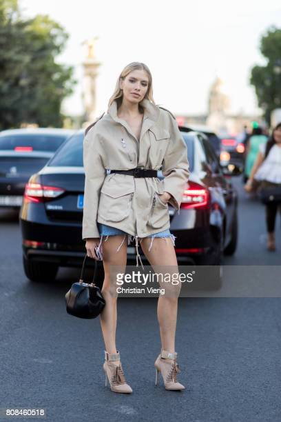 Elena Perminova wearing a trench jacket outside Alexandre Vauthier during Paris Fashion Week Haute Couture Fall/Winter 20172018 Day Three on July 4...