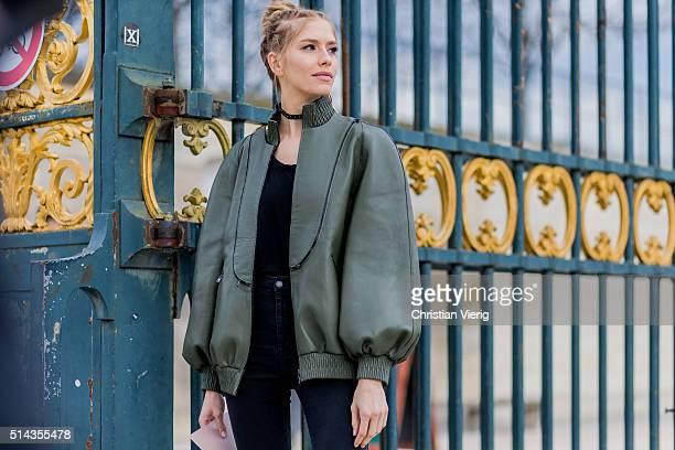 Elena Perminova wearing an olive Fendi bomber jacket and black Prada bag outside Valentino during the Paris Fashion Week Womenswear Fall/Winter...