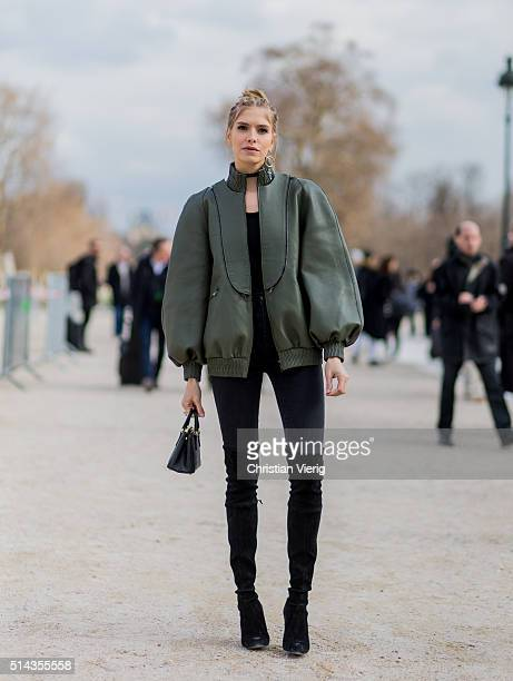 Elena Perminova wearing an olive Fendi bomber jacket and black Prada bag outside Valentino during the Paris Fashion Week Womenswear Fall/Winter...