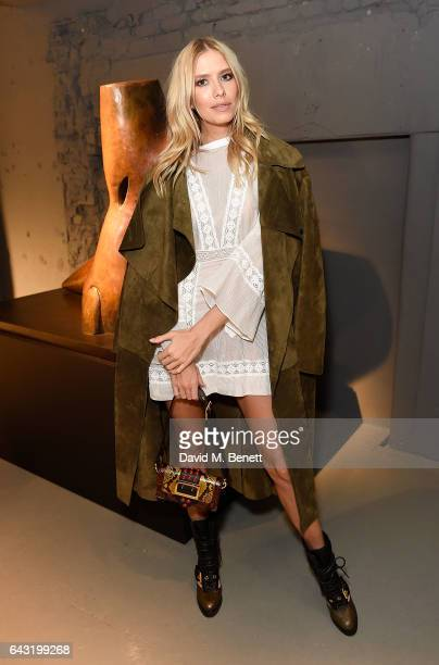 Elena Perminova wearing Burberry attends the Burberry February 2017 Show during London Fashion Week February 2017 at Makers House on February 20 2017...