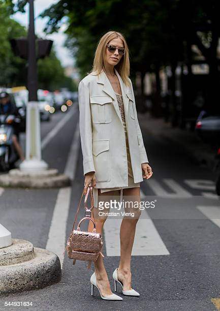 Elena Perminova wearing Dior bag outside Dior during Paris Fashion Week Haute Couture F/W 2016/2017 on July 4 2016 in Paris France