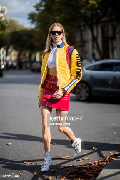 Elena Perminova wearing yellow Miu Miu leather jacket red leather skirt cropped top seen outside Miu Miu during Paris Fashion Week Spring/Summer 2018...