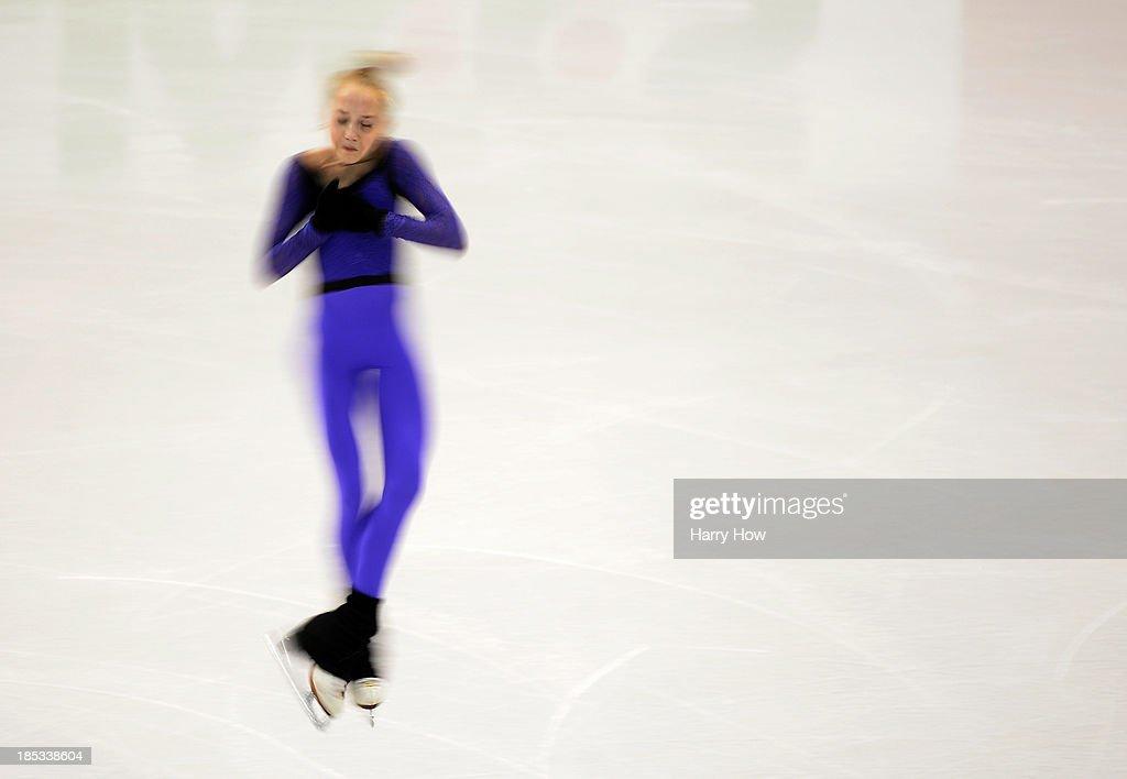 Elena Radionova of Russia spins during practice at Skate America 2013 at Joe Louis Arena on October 18, 2013 in Detroit, Michigan.