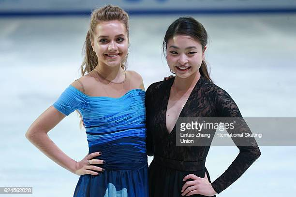 Elena Radionova of Russia with Maia Shibutani of United States pose for a phot during the Exhibition Program on day three of Audi Cup of China ISU...