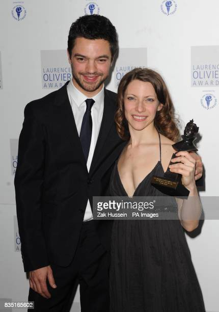 Elena Roger wins the Best Actress in a Musical Award presented by Dominic Cooper during the Laurence Olivier Awards at the Grosvenor Hotel in central...