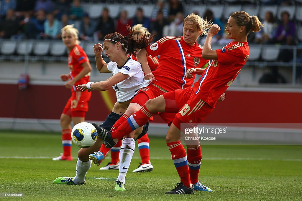Elena Terekhova (C) and Alla Sidorovskaya of Russia (R) challenges Jill Scott of England (L) during the UEFA Women's EURO 2013 Group C match between England and Russia at Linkoping Arena on July 15, 2013 in Linkoping, Sweden.