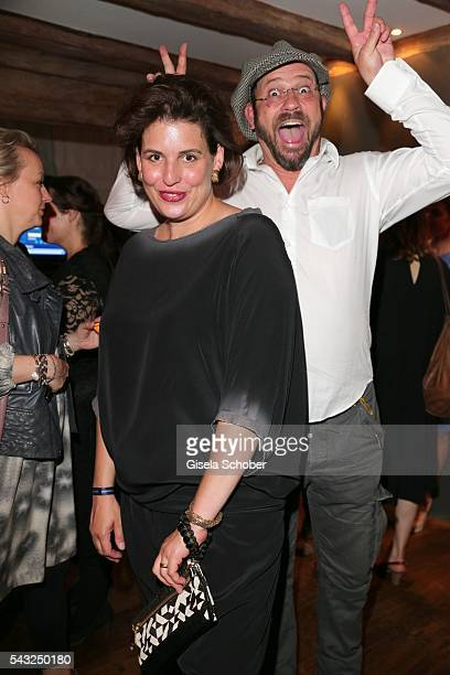 Elena Uhlig and Michel Guillaume makes a photo bomb during the Peugeot BVC Casting Night during the Munich Film Festival 2016 at Kaeferschaenke on...