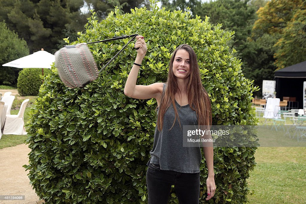 Elena Uriz Lopez seen wearing a Bershka's top, a Zara's pants, a Bimba & Lolo's handbag and Bershka's shoes during the 'Festival Jardins de Pedralbes' on June 25, 2014 in Barcelona, Spain.
