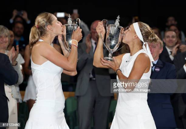 Elena Vesnina and Ekaterina Makarova celebrate following their Ladies Doubles Final on day twelve of the Wimbledon Championships at The All England...