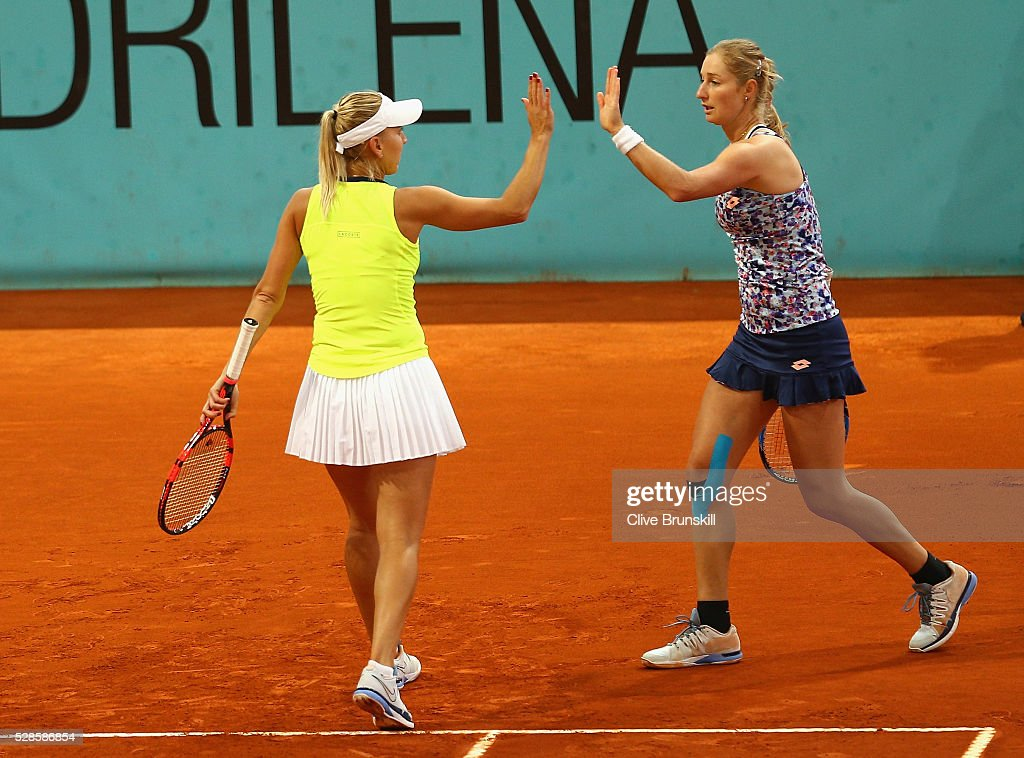 <a gi-track='captionPersonalityLinkClicked' href=/galleries/search?phrase=Elena+Vesnina&family=editorial&specificpeople=552598 ng-click='$event.stopPropagation()'>Elena Vesnina</a> and <a gi-track='captionPersonalityLinkClicked' href=/galleries/search?phrase=Ekaterina+Makarova&family=editorial&specificpeople=2364239 ng-click='$event.stopPropagation()'>Ekaterina Makarova</a> of Russia celebrate a point against Caroline Garcia and Kristina Mladenovic of France in their doubles semi final match during day seven of the Mutua Madrid Open tennis tournament at the Caja Magica on May 06, 2016 in Madrid,Spain.