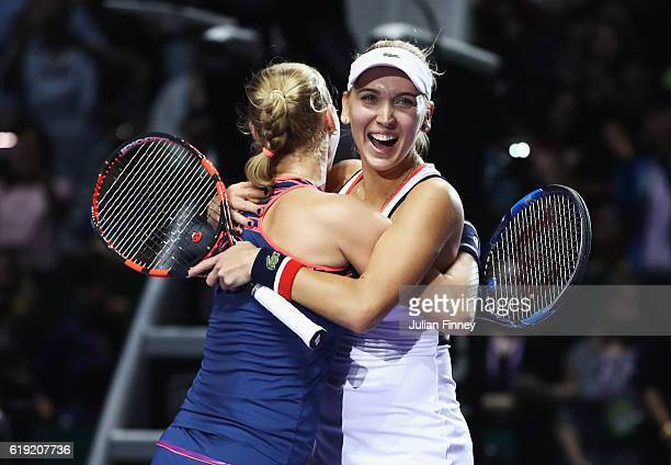 Elena Vesnina and Ekaterina Makarova of Russia celebrate victory in the doubles final match against Bethanie MattekSands of the United States and...