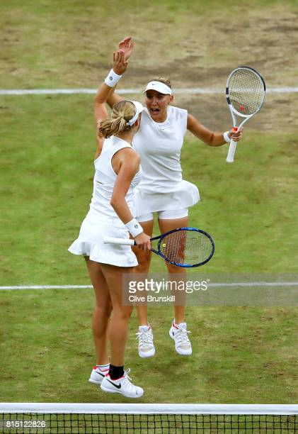 Elena Vesnina and Ekaterina Makarova of Russia celebrate victory in the Ladies Doubles Final against HaoChing Chan of Chinese Taipei and Monica...