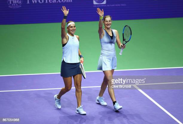 Elena Vesnina and Ekaterina Makarova of Russia celebrate victory in the doubles match against YiFan Xu of China and Gabriela Dabrowski of Canada...